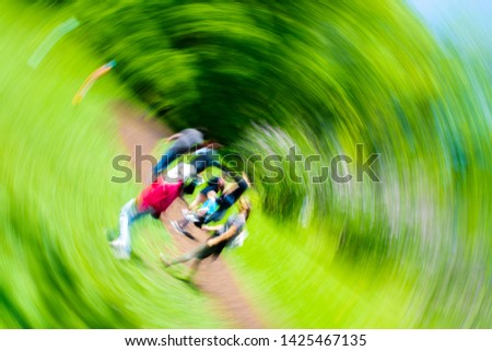 Bright photo with blurred view of group of people, can be used to illustrate some physical conditions such as dizziness and unconsiousness. #1425467135