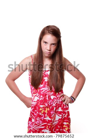 Bright picture of a healthy, teenage girl with long brown hair on isolated white background looking annoyed