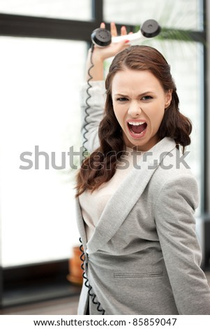 bright picture of angry businesswoman with phone