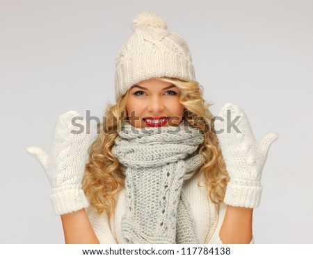 bright picture of beautiful woman in hat, muffler and mittens..