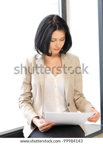 bright picture of calm woman with documents - stock photo