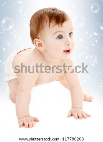 bright picture of crawling baby boy in diaper with soap bubbles