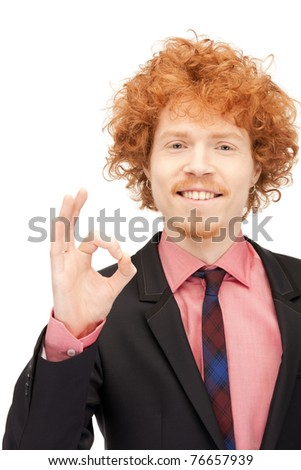 bright picture of handsome man showing ok sign - stock photo