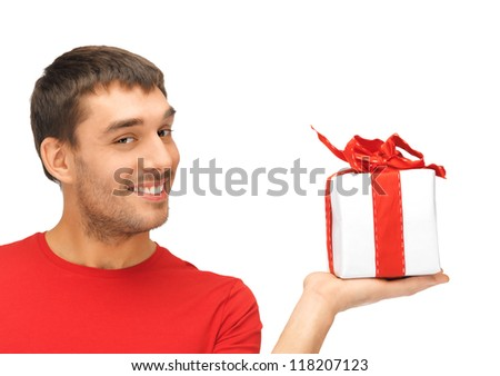 bright picture of handsome man with a gift .