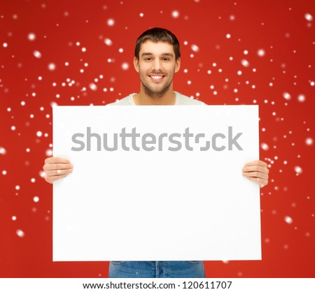 bright picture of handsome man with big blank board.