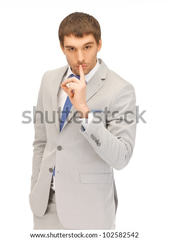 bright picture of handsome man with finger on lips