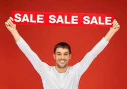 bright picture of handsome man with sale sign.