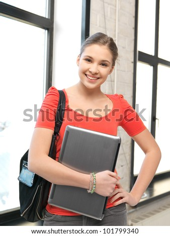 bright picture of happy and smiling teenage girl with laptop