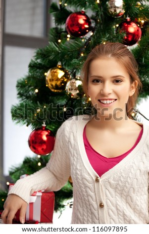 bright picture of happy and smiling woman with christmas tree...
