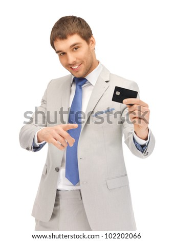 bright picture of happy businessman with credit card