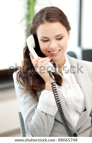 bright picture of happy businesswoman with phone