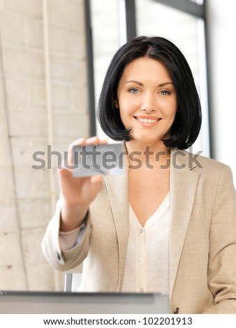 bright picture of happy woman with credit card