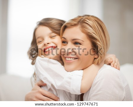 bright picture of hugging mother and daughter #129747671