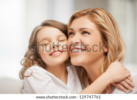 bright picture of hugging mother and daughter