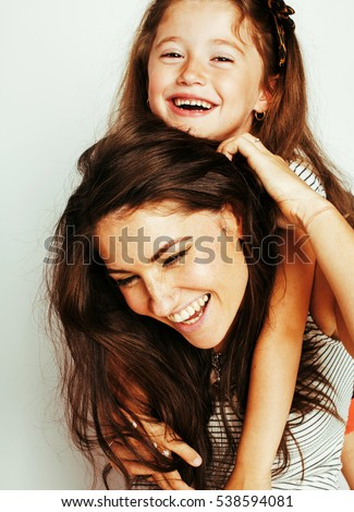 bright picture of hugging mother and daughter happy together, smiling stylish family. lifestyle people concept