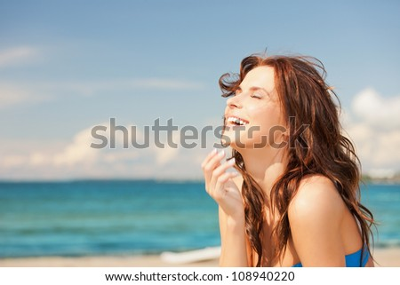 bright picture of laughing woman on the beach. #108940220