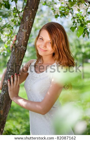 bright picture of lovely brunette woman in summer