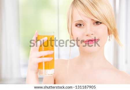 bright picture of lovely girl with a glass of juice