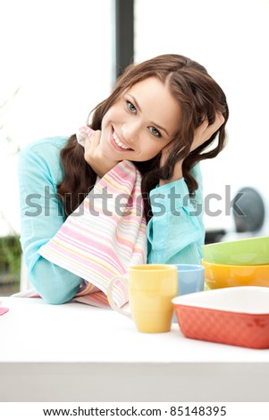 bright picture of lovely housewife at the kitchen