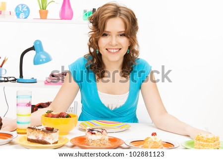 bright picture of lovely housewife at the kitchen sweets