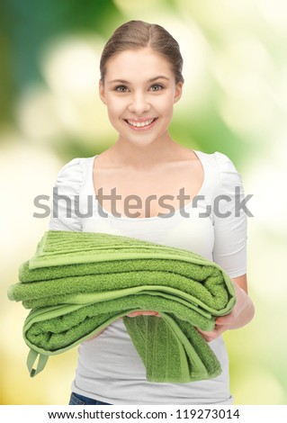 bright picture of lovely housewife with towels