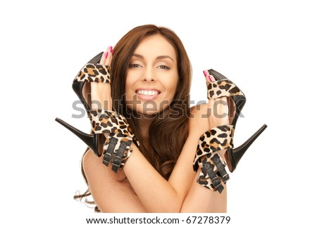 bright picture of lovely woman with leopard shoes over white