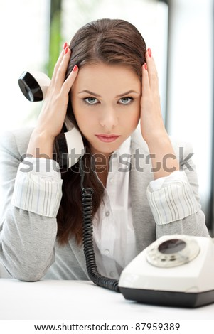 bright picture of sad businesswoman with phone