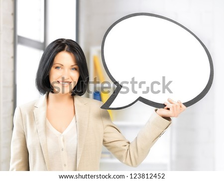 bright picture of smiling businesswoman with blank text bubble - stock photo