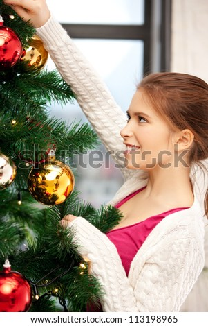 bright picture of woman decorating christmas tree.....