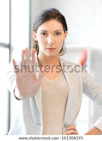 bright picture of young woman making stop gesture