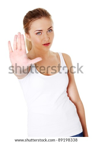 Bright picture of young woman making stop gesture.