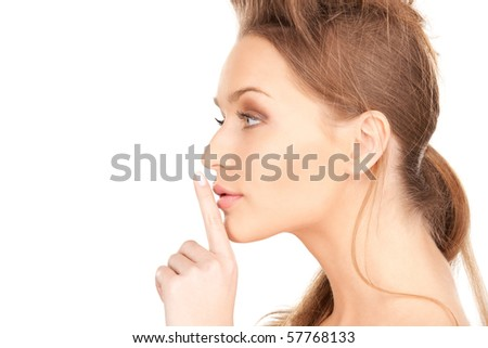 bright picture of young woman with finger on lips #57768133
