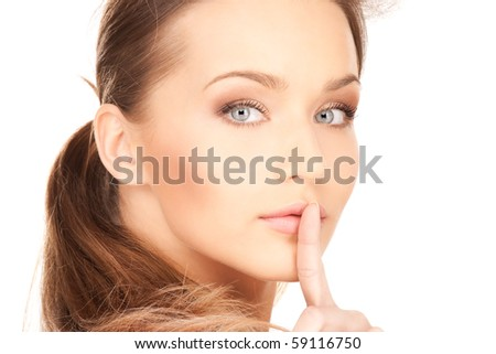 bright picture of young woman with finger on lips
