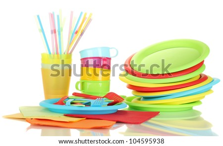 bright plastic disposable tableware isolated on white background