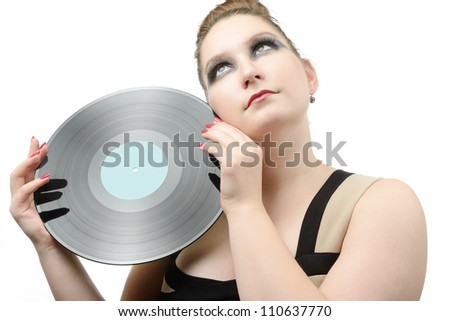 Bright portrait beautiful young girl with a vinyl record, musical romantic concept