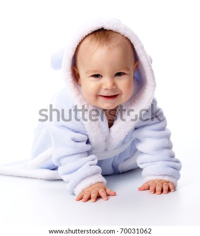 Bright portrait of a cheerful child in blue bathrobe, isolated over white