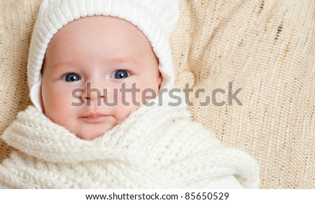bright portrait of adorable baby in the cap