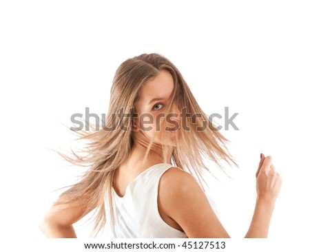 Bright portrait of happy girl in half turn over white