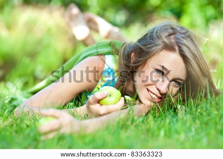 Bright  portrait of happy healthy woman holding apple