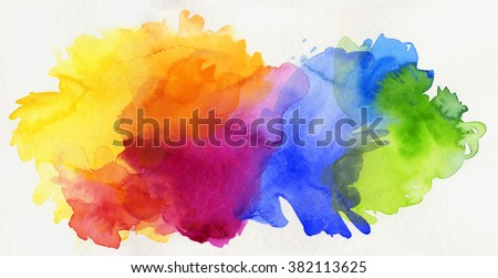 bright rainbow colored watercolor paints isolated on white paper