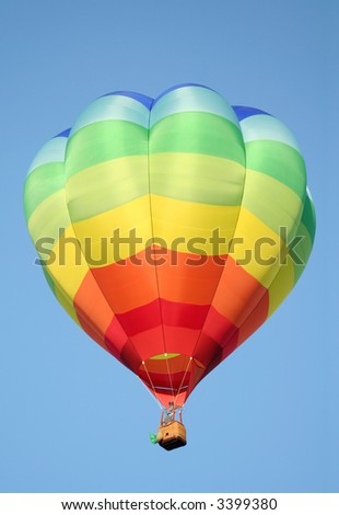 Bright Rainbow Striped Hot Air Balloon - stock photo