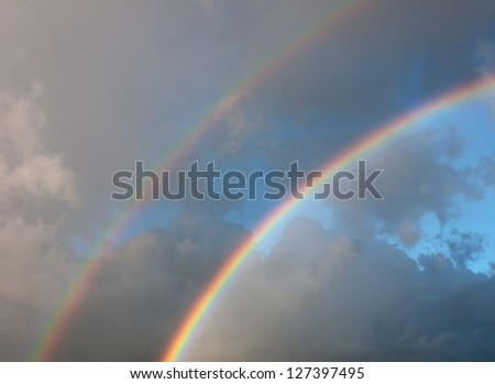 Bright real rainbow sky background