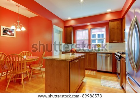 Bright red and brown kitchen.