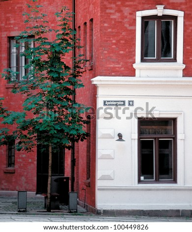 Bright red-and-white house in the city Oslo - Norway