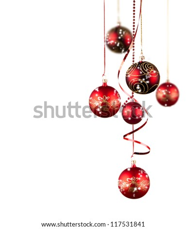 Bright red Christmas tree balls with curly ribbons isolated on the white background
