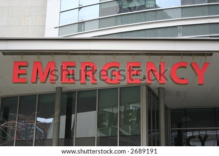 Bright red Emergency room sign on Hospital building
