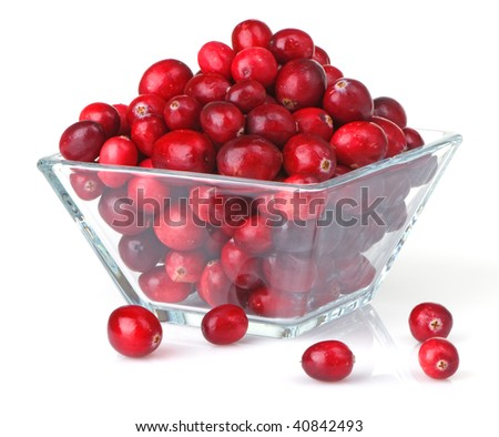 Bright red fresh cranberries in a square glass bowl