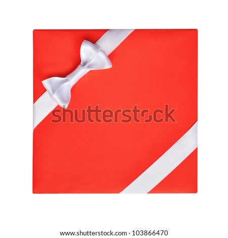 Bright red gift with a white ribbon bow, isolated on white