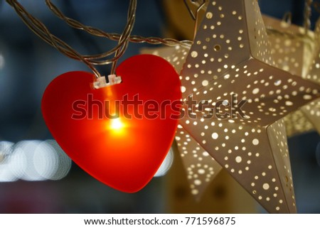 Bright red heart hanging with white star #771596875