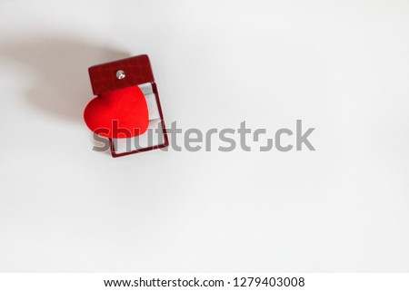 Bright red heart in opened leather jewellery box on white background with copy space, top view #1279403008
